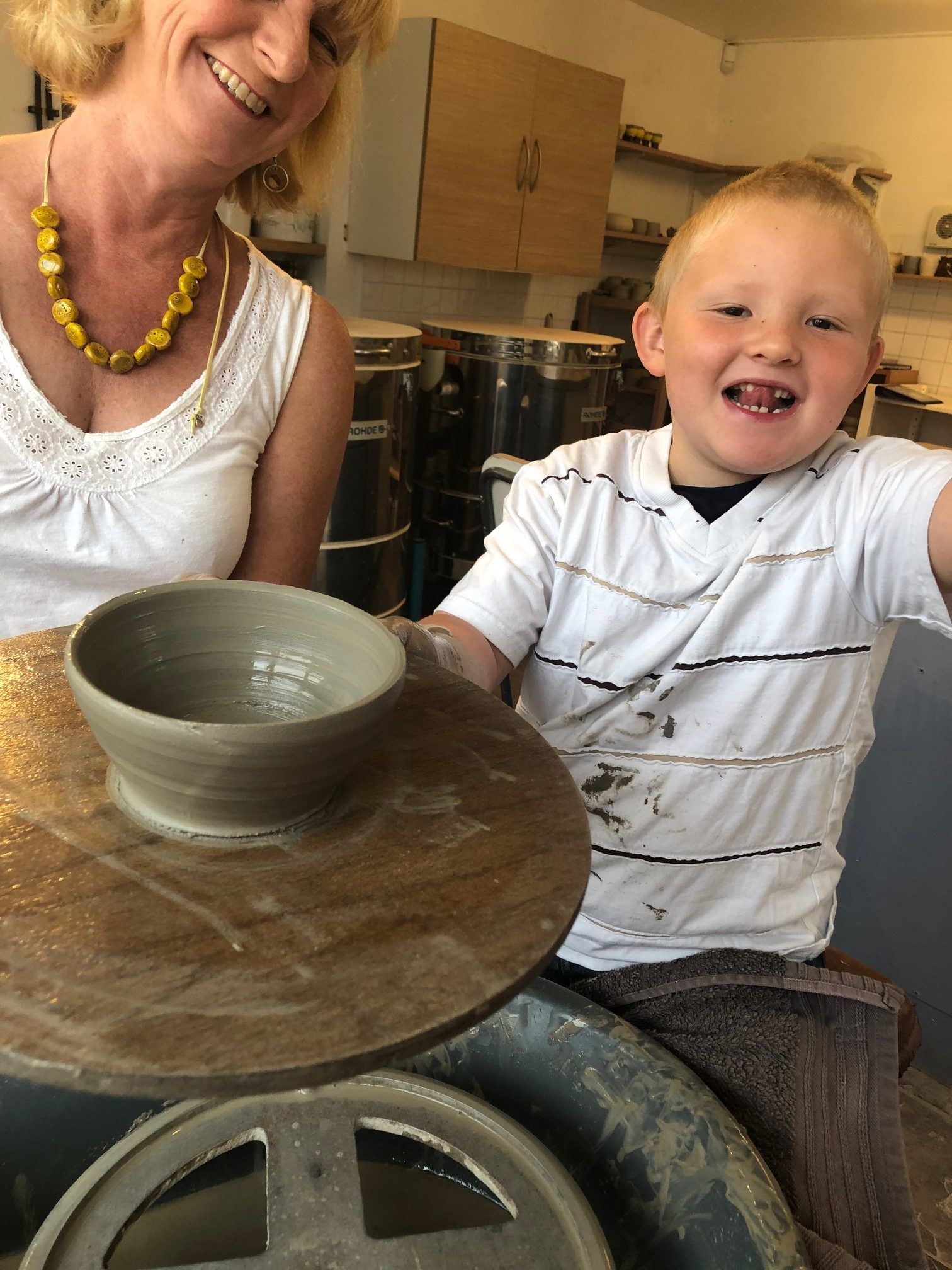 Throwing pots on the wheel in a class